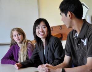 Dr. Flora Wei, center, conversing with students.