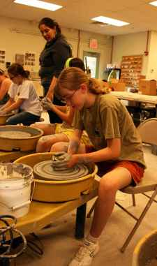 Claire Mulcahy working on a potter's wheel during last year's summer camp at UPB.