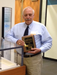 Friends of Hanley Library board member Roger Peters with the Friends of ULS Award given to the group.