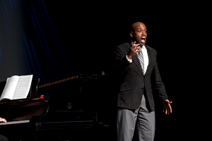 DeAndre Simmons performing in the Bromeley Family Theater as part of Pitt-Bradford's 50th Anniversary Gala in 2013. Photo by Alan Hancock.