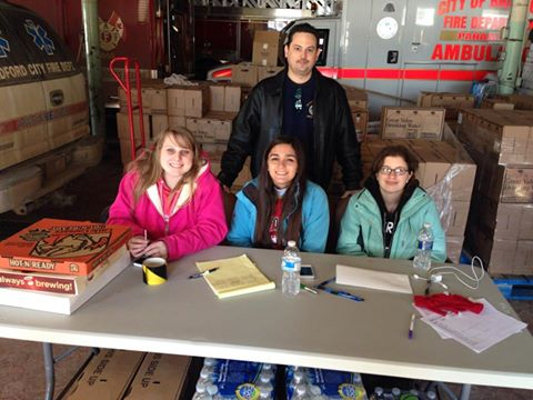 Bartlett distributing water at the City of Bradford Fire Station with the BHS Criminal Justice Club